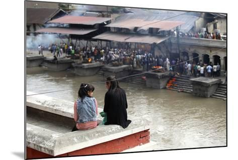 Girls Watch Hindu Cremations at Pashupatinath Temple-Jill Schneider-Mounted Photographic Print