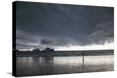 A Person Walking Along a Beach as an Afternoon Storm Approaches Railay Beach-Erika Skogg-Stretched Canvas Print
