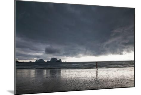 A Person Walking Along a Beach as an Afternoon Storm Approaches Railay Beach-Erika Skogg-Mounted Photographic Print