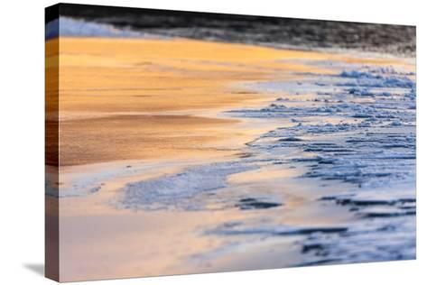 Orange Light from the Sunrise Reflects Off Smooth Ice, Contrasting with the Blue Rough Ice-Jak Wonderly-Stretched Canvas Print