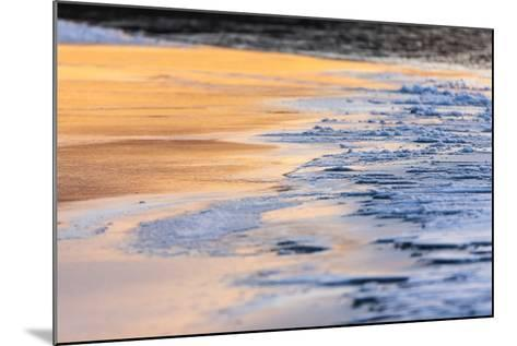 Orange Light from the Sunrise Reflects Off Smooth Ice, Contrasting with the Blue Rough Ice-Jak Wonderly-Mounted Photographic Print