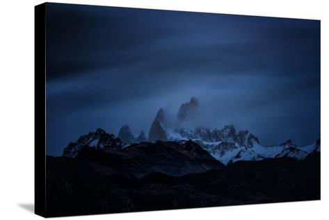 Snow-Blanketed Andes Mountains at Night with Flowing Clouds--Stretched Canvas Print
