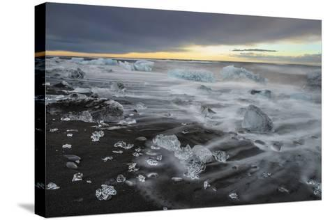 Crystal Clear Icebergs and Volcanic Sand Beach on the Atlantic Shore Near Jokulsarlon Glacier Lake-Babak Tafreshi-Stretched Canvas Print