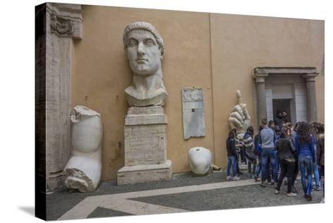 Tourists Line Up at the Entrance of the Capitoline Museum Next to a Bust of Constantine-Will Van Overbeek-Stretched Canvas Print