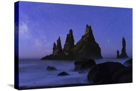 Night Sky and the Milky Way at the Break of Dawn over the Basalt Sea Stacks known as Reynisdrangar-Babak Tafreshi-Stretched Canvas Print
