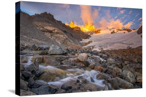 Alpenglow at Sunrise over a Patagonia Landscape with Snow and a Rushing, Cascading Stream--Stretched Canvas Print