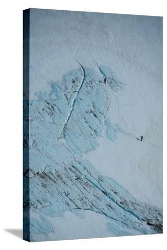 An Aerial View of Hikers in a Vast Patagonia Landscape of Snow and Ice--Stretched Canvas Print