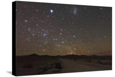 The Large Magellanic Cloud and Bright Star Canopus in the Southern Sky over the Atacama Desert-Babak Tafreshi-Stretched Canvas Print