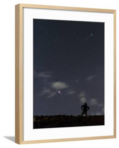 A Man and the Night Sky, with the Pink-Red Orion Nebula Near the Center, and Comet Lovejoy at Top-Babak Tafreshi-Framed Art Print