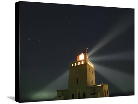 Stars Above a Lighthouse in Southern Iceland-Babak Tafreshi-Stretched Canvas Print