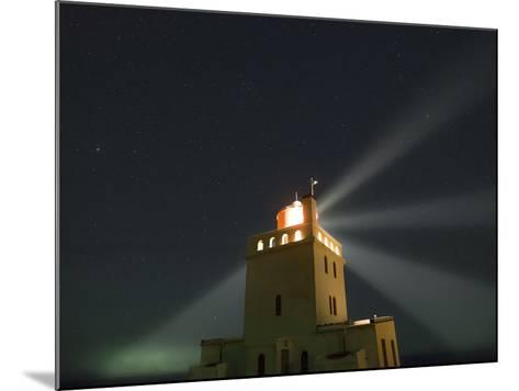 Stars Above a Lighthouse in Southern Iceland-Babak Tafreshi-Mounted Photographic Print