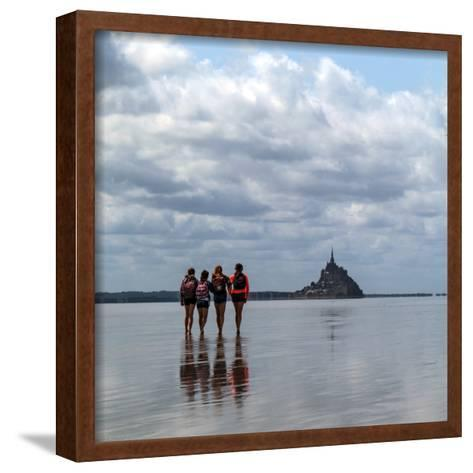 Tourists Walk the Sea Floor at Low Tide to the World Heritage Site Mont Saint Michel Monastery-Babak Tafreshi-Framed Art Print