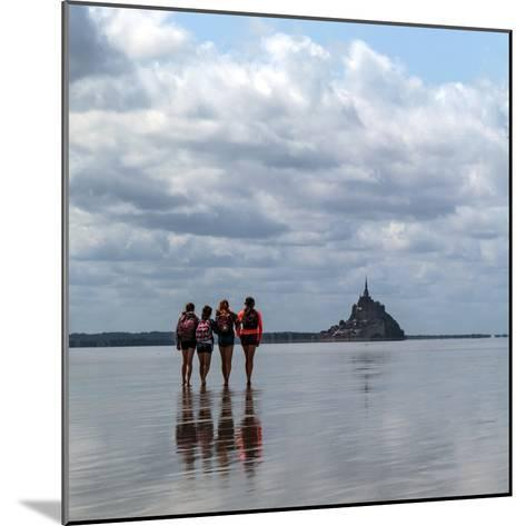Tourists Walk the Sea Floor at Low Tide to the World Heritage Site Mont Saint Michel Monastery-Babak Tafreshi-Mounted Photographic Print