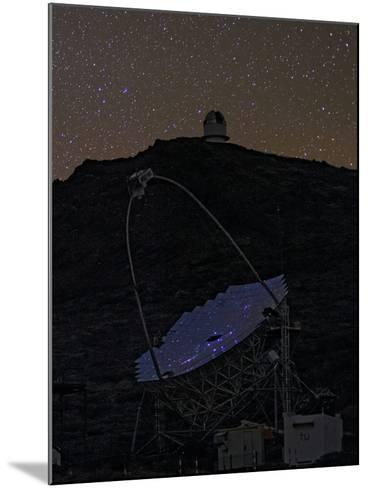 The Night Sky Reflected in the Multi-Mirrored Surface of a Telescope-Babak Tafreshi-Mounted Photographic Print