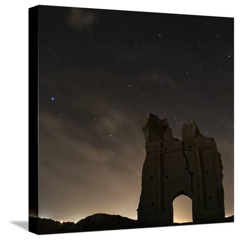 Sirius and Constellations Orion and Taurus over Ruins of the Ancient City Gate of Sar Yazd-Babak Tafreshi-Stretched Canvas Print