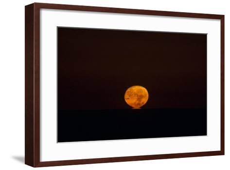 The Nearly Full Moon, Distorted by Atmospheric Refraction, Appearing to Sink into the Atlantic-Babak Tafreshi-Framed Art Print