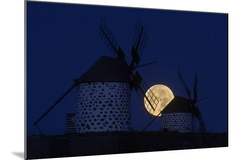 The Full Moon, a Wolf Moon, First Full Moon after the Winter Solstice, at Dawn Behind Windmills-Babak Tafreshi-Mounted Photographic Print