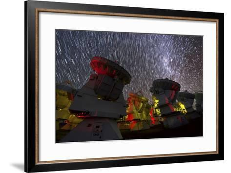 A Time-Exposure Image of Star Trails over the Alma Radio Telescopes, 5000 Meters High in the Andes-Babak Tafreshi-Framed Art Print
