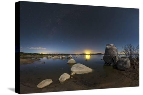 In a Moonlit Night the Milky Way Appears Above Lake Alqueva, Portugal-Babak Tafreshi-Stretched Canvas Print