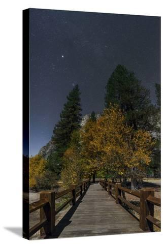 Planet Jupiter, in Constellation Taurus, Above a Footbridge over the Merced River-Babak Tafreshi-Stretched Canvas Print