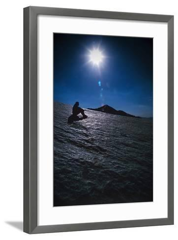 A Hiker Sits on a Glacier Near the Peak of Mount Sialan in the Alborz Mountains of Iran-Babak Tafreshi-Framed Art Print