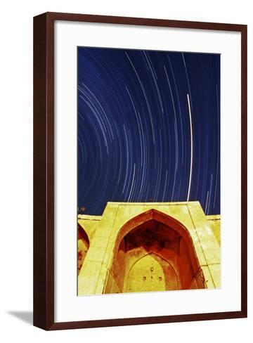 A Time-Exposure of Star Trails Above a Historic Caravansary. the Brightest Trail Is Planet Mars-Babak Tafreshi-Framed Art Print
