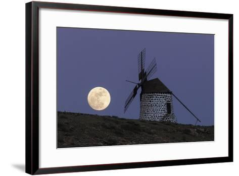 The Full Moon, and Wolf Moon, the First Full Moon after the Winter Solstice, over a Windmill-Babak Tafreshi-Framed Art Print