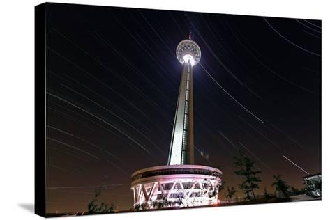 A Three Hour Time-Exposure of Star Trails Above the Milad Communication Tower in Tehran-Babak Tafreshi-Stretched Canvas Print