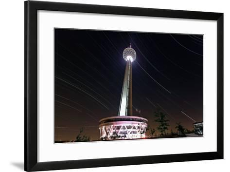 A Three Hour Time-Exposure of Star Trails Above the Milad Communication Tower in Tehran-Babak Tafreshi-Framed Art Print