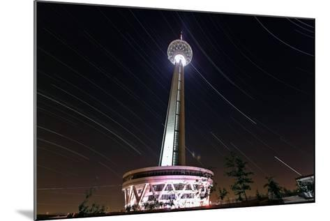 A Three Hour Time-Exposure of Star Trails Above the Milad Communication Tower in Tehran-Babak Tafreshi-Mounted Photographic Print
