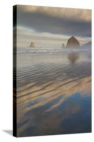 Haystack Rock, the Needles, and Reflections of Clouds at Sunrise-Greg Winston-Stretched Canvas Print