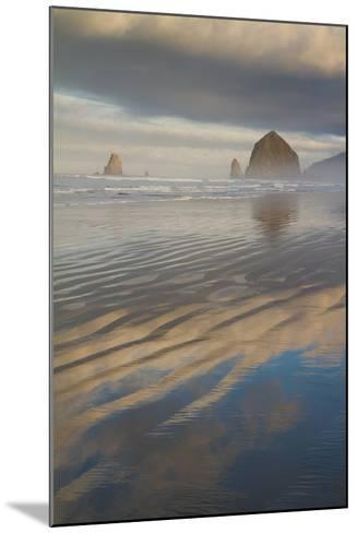 Haystack Rock, the Needles, and Reflections of Clouds at Sunrise-Greg Winston-Mounted Photographic Print