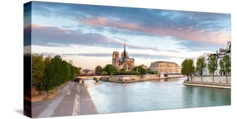 Notre Dame Cathedral on the Banks of the Seine River at Sunrise, Paris, Ile-De-France, France--Stretched Canvas Print
