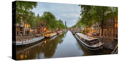 Prinsengracht Canal at Dusk with Westerkerk in Distance, Amsterdam, North Holland, Netherlands--Stretched Canvas Print
