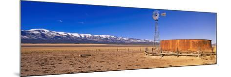 This Is an Old Wooden Windmill in an Open Field in the Old West--Mounted Photographic Print