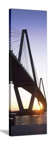 Bridge across a River at Dusk--Stretched Canvas Print