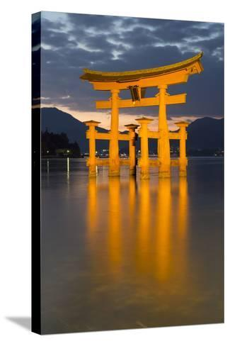 The Floating Miyajima Torii Gate of Itsukushima Shrine at Dusk-Stuart Black-Stretched Canvas Print