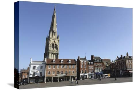 The Spire of St. Mary Magdalene Church Rises over Building on the Market Square-Stuart Forster-Stretched Canvas Print