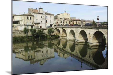 A Roman Bridge, Built in the Reign of the Emperor Tiberius, Spans the River Vidourle at Sommieres-Stuart Forster-Mounted Photographic Print