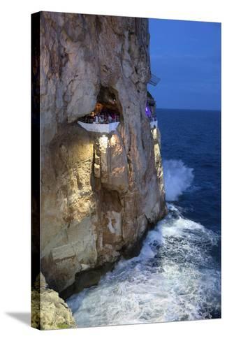 Bar Built in Cliff Caves, Cova D'En Xoroi in Evening, Cala En Porter-Stuart Black-Stretched Canvas Print