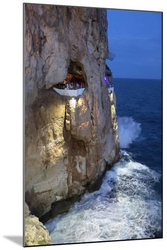 Bar Built in Cliff Caves, Cova D'En Xoroi in Evening, Cala En Porter-Stuart Black-Mounted Photographic Print