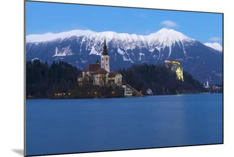 The Assumption of Mary Pilgrimage Church on Lake Bled and Bled Castle at Dusk, Bled, Slovenia-Miles Ertman-Mounted Photographic Print