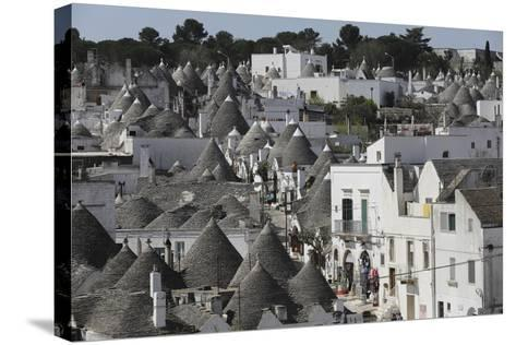 Cone-Roofed Trulli Houses on the Rione Monte District, Alberobello, Apulia, Italy-Stuart Forster-Stretched Canvas Print