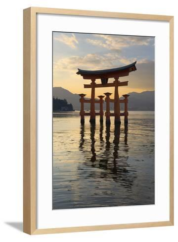 The Floating Miyajima Torii Gate of Itsukushima Shrine at Sunset-Stuart Black-Framed Art Print