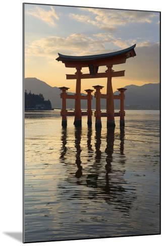 The Floating Miyajima Torii Gate of Itsukushima Shrine at Sunset-Stuart Black-Mounted Photographic Print