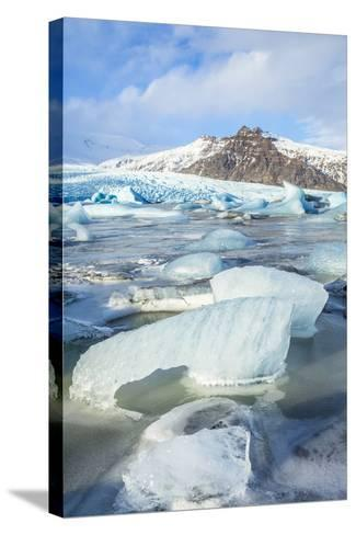 Frozen Icebergs in the Frozen Waters of Fjallsarlon Glacier Lagoon, South East Iceland, Iceland-Neale Clark-Stretched Canvas Print