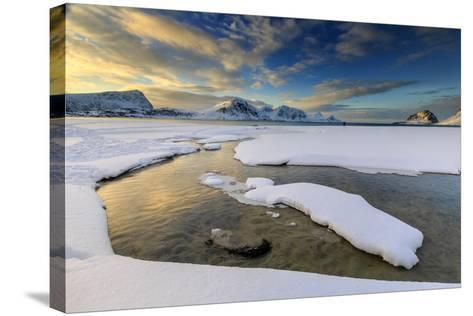The Golden Sunrise Reflected in a Pool of the Clear Sea Where the Snow Has Melted-Roberto Moiola-Stretched Canvas Print