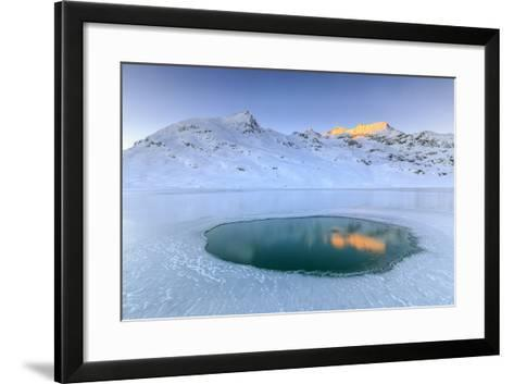 The Piz Cambrena Illuminated by the Sun Reflecting in a Pool Surrounded by Ice at the Bernina-Roberto Moiola-Framed Art Print