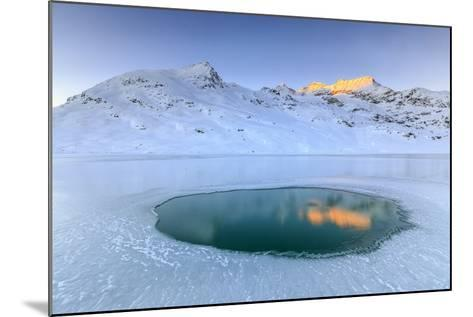 The Piz Cambrena Illuminated by the Sun Reflecting in a Pool Surrounded by Ice at the Bernina-Roberto Moiola-Mounted Photographic Print