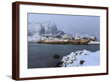 Snowy Peaks and Rorbu, the Red Houses of Fishermen, in the Landscape of the Lofoten Islands-Roberto Moiola-Framed Art Print